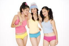 Colorful Friends. Three young asian women in colorful outfits Royalty Free Stock Images