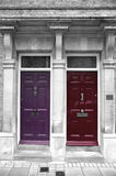 Colorful front doors, London. Two colorful front doors, and part of a home in London, United Kingdom Royalty Free Stock Photography