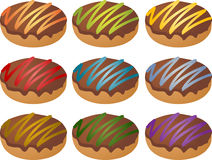 Colorful frosted icing donuts Royalty Free Stock Image