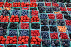 Colorful fruit and berries at an outdoor market. stock photos
