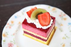 Colourful fruit cake. On a plate royalty free stock photo