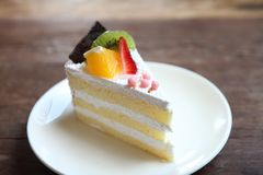 Colorful fruit cake, Dessert. Colorful fruit cake on a plate royalty free stock photography