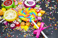 Colorful fruit candies and lollipops Stock Photos