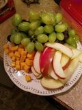 Colorful fruit and cheese plate royalty free stock photos