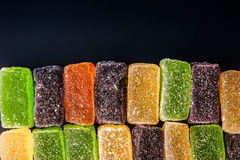 Colorful fruit jellies on the dark background Stock Photo