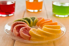 Colorful fruit jelly candies arranged in circle on wooden table. Stock Photography