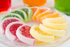 Colorful fruit jelly candies arranged in circle on wooden table. Stock Image