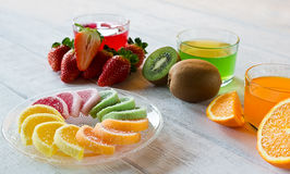 Colorful fruit jelly candies arranged in circle on wooden table. Stock Photo