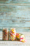 Colorful fruit jelly candy on wooden Royalty Free Stock Photos
