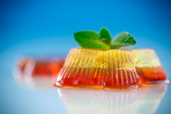 Colorful fruit jelly. Sweets on a blue background Stock Photo