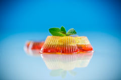 Colorful fruit jelly. Sweets on a blue background Royalty Free Stock Images