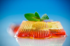 Colorful fruit jelly. Sweets on a blue background Stock Photography