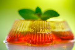 Colorful fruit jelly. Sweets on a green background Royalty Free Stock Photo