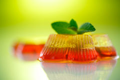 Colorful fruit jelly. Sweets on a green background Royalty Free Stock Image