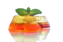 Colorful fruit jelly. Sweets on a white plate Stock Photos