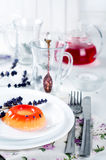 Colorful fruit jelly sweets on a white plate. With lavander and tea Royalty Free Stock Photography