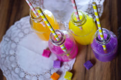 Colorful fruit juice health smoothie straw bottle Royalty Free Stock Images