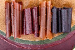 Colorful fruit leather rolls stock image