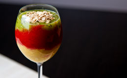 Colorful fruit mousse in glass Royalty Free Stock Photography