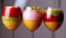 Colorful fruit mousse in glass Stock Images