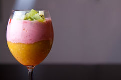 Colorful fruit mousse in glass Stock Photos