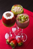Colorful fruit mousse in glass Stock Image