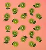 Colorful fruit pattern of fresh kiwi slices on pink background royalty free stock photo