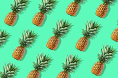 Colorful fruit pattern of fresh whole pineapples stock photography