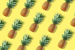 Colorful fruit pattern of fresh whole pineapples royalty free stock photography