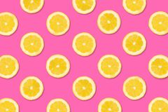 Fruit pattern of lemon slices on a pastel pink background. Colorful fruit pattern. Lemon slices on a pastel pink background. Top view royalty free stock image