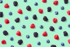 Colorful fruit pattern of wild berries royalty free stock photo
