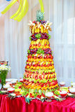 Colorful fruit pyramid on banquet Stock Images