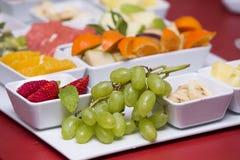 Colorful fruit salad. Apple, pear, banana, tangerine, pear and pomegranate fruit salad. Fresh summer eating. Stock Photo