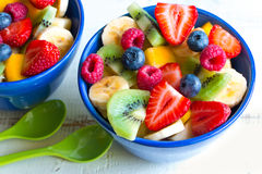 Colorful fruit salad in bowls Stock Photography