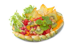 Colorful  fruit salad in cantaloupe melon Royalty Free Stock Photos