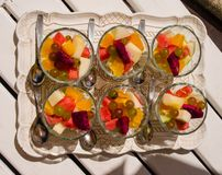 Colorful fruit salad in glasses royalty free stock photos