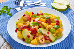 Colorful fruit salad with mint leaves Royalty Free Stock Photos