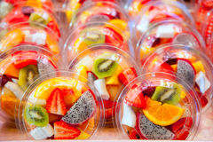 Colorful fruit salad in transparent glasses Stock Photography