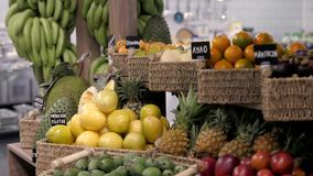 Colorful fruit stand in a local market pineapple, mango, passion fruit asia. Colorful fruit stand in a local market stock footage