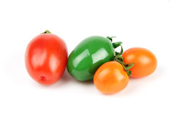 Colorful fruits. Cherry tomatoes painted in different color isolated on white background Royalty Free Stock Images