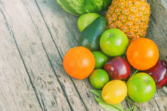 Colorful fruits on brown wood in natural light Royalty Free Stock Images