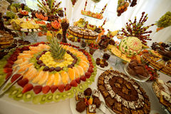 Colorful fruits and cakes on table at a wedding Royalty Free Stock Images