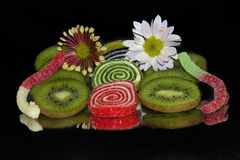Colorful Fruits and candies. Multicolored fruits and candies  on the mirror Royalty Free Stock Photo