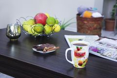 Fruit and coffee on the table stock photography