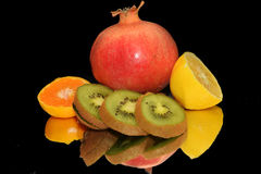 Colorful Fruits. Multicolored fruits  on the mirror Stock Photos