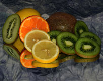 Colorful Fruits. Multicolored fruits  on the mirror Stock Photo