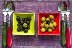 Colorful fruits olives bowls wooden table Stock Image