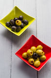 Colorful fruits olives bowls wooden table Royalty Free Stock Image