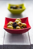 Colorful fruits olives bowls wooden table Stock Images