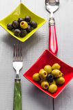 Colorful fruits olives bowls wooden table cutlery Stock Image